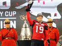 Calgary Stampeders quarterback Bo Levi Mitchell holds the most valuable player award after winning the team won the Grey Cup defeating the Ottawa Redblacks at Commonwealth Stadium in Edmonton on Sunday November 25, 2018.
