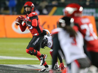 Calgary Stampeders quarterback Bo Levi Mitchell looks for a receiver during Grey Cup action against the Ottawa Redblacks at Commonwealth Stadium in Edmonton on Sunday November 25, 2018.