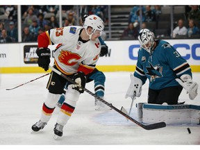 Calgary Flames' Sam Bennett (93) shoots the puck at the net as San Jose Sharks goaltender Martin Jones (31) makes the save in the first period of an NHL hockey game in San Jose, Calif., Sunday, Nov. 11, 2018.