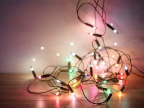 Blur christmas lights on wooden planks, low depth of focus with copy space in concept vintage tone style.