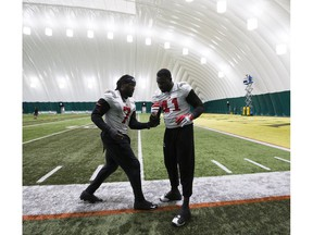 The Calgary Stampeders  Junior Turner, left, and Cordarro Law ,right, work on drills during practice in preparation for the Grey Cup, on Wednesday, Nov. 21, 2018, in Edmonton.