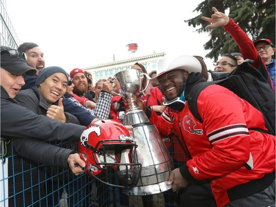 Calgary Stampeders Derek Wiggan with the cup as thousands of fans turned out for a rally celebrating the Calgary Stampeders victory in the 106th Grey Cup outside city hall in Calgary on Tuesday, Nov. 27, 2018.