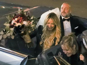 Annie Arbic arrives with Hells Angel member Martin Robert in a convertible Cadillac for their wedding in downtown Montreal on Saturday Dec. 1, 2018.