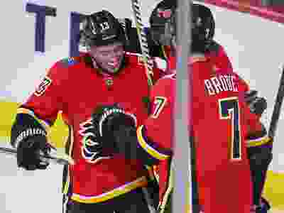 Johnny Gaudreau, Elias Lindholm and T.J. Brodie celebrate after Lindholm scored and Gaudreau assisted during NHL action against the Minnesota Wild at the Scotiabank Saddledome in Calgary on Thursday December 6, 2018.