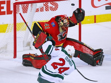 Calgary Flames goaltender Mike Smith deflects this slap shot by the Minnesota Wild's Matt Dumba during NHL action at the Scotiabank Saddledome in Calgary on Thursday December 6, 2018.