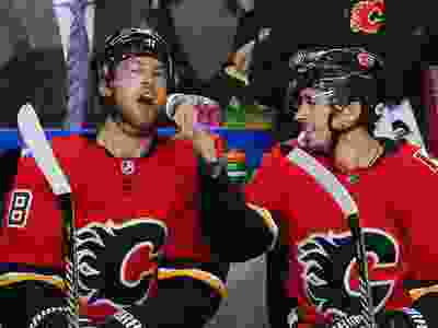 Johnny Gaudreau squirts gatorade into Elias Lindholm's mouth after Lindholm scored and Gaudreau assisted during NHL action against the Minnesota Wild at the Scotiabank Saddledome in Calgary on Thursday December 6, 2018.