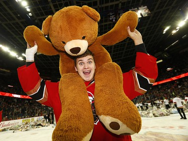 Calgary Hitmen Egor Zamula with the thousands of teddy bears during the 24th annual Brick Teddy Bear Toss game against the Kamloops Blazers at the Scotiabank Saddledome in Calgary on Sunday December 9, 2018.