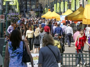 People crowd Stephen Avenue on a warm spring day.