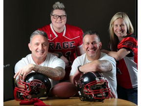 Keith Crawford, left and Wes Lysack are announced as the Western Women's Canadian Football team, Calgary Rage, head coaches in Calgary, on Thursday. Pictured with them are Rage team members Erin Walton, left and Tatrina Medvescek-Valentine. Photo by Leah Hennel/Postmedia.