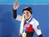 (FILES) In this photo on February 20, 2014 Canada's gold medalist Kaillie Humphries waves to the crowd during the Women's Bobsleigh Medal Ceremony at the Sochi medals plaza during the Sochi Winter Olympics. Kaillie Humphries, set to make history on December 20, 2014 as one of the first women to pilot a four-man bobsleigh World Cup team, doesn't have time to worry about political correctness.  AFP PHOTO / LOIC VENANCELOIC VENANCE/AFP/Getty Images