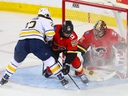 Calgary Flames goalie David Rittich makes a save on Buffalo Sabres' Johan Larsson at the Saddledome on Wednesday, Jan. 16, 2019.
