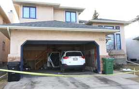 Police investigate a suspected homicide in a home on Edgepark Way N.W. in Calgary on Jan. 10, 2018.