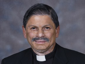 A Calgary Catholic priest has been charged for allegedly sexually touching a woman on 'several occasions' while working at by a priest at the St. Mark Roman Catholic Church, pictured here.