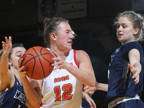 The Calgary Dinos women's basketball squad faces the Regina Cougars in their Canada West semifinal series. Photo by David Moll/Special to Postmedia.