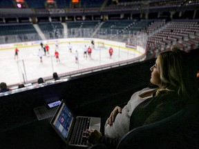 Postmedia sports reporter Kristen Anderson watches Calgary Flames practice at the Saddledome in Calgary, on Thursday Dec. 6, 2018.