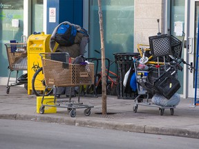 Shopping carts are parked next to a needle drop box outside safe injection site at the Sheldon M. Chumir Health Centre on Tuesday December 11, 2018. Gavin Young/Postmedia
