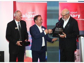 Ken KIng (R) from the Calgary Sports and Entertainment Corp. accepts the Ron Southern Business and Sport Award Calgary during the Celebration of Sport 2018 held at Winsport in Calgary on Thursday, October 11, 2018. Jim Wells/Postmedia
