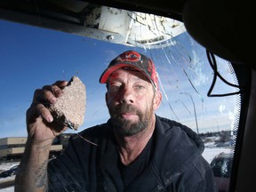 Darren Malo holds a rock which struck his truck on Deerfoot Trail on Feb. 27, 2019. Malo said the rock was thrown from the 8th Avenue N.E. bridge.