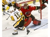 Calgary Flames goalie, Mike Smith makes a save on a Pittsburgh Penguins shot in first period action at the Scotiabank Saddledome in Calgary on Thursday October 25, 2018. Darren Makowichuk/Postmedia