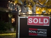 Luxury home sales in the Greater Toronto Area, Oakville and Hamilton-Burlington have fallen by almost 60 per cent year-over-year. A real estate sold sign hangs in front of a west-end Toronto property Friday, Nov. 4, 2016. THE CANADIAN PRESS/Graeme Roy ORG XMIT: CPT108