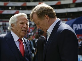 In this Nov. 19, 2017, file photo, NFL Commissioner Roger Goodell, right, talks with New England Patriots owner Robert Kraft before the Patriots face the Oakland Raiders in Mexico City.