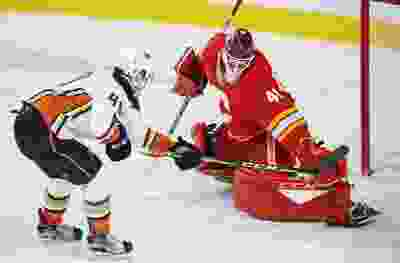 Calgary Flames goaltender Mike Smith stops this scoring chance by the Anaheim Ducks' Max Jones during NHL action in Calgary on Friday, March 29, 2019.
