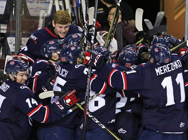 The Lethbridge Hurricanes celebrate after scoring in overtime to defeat the Calgary Hitmen 7-6 in Calgary on Sunday, March 31, 2019. The win forced a seventh game in their play-off series.