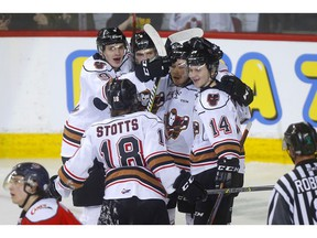 Calgary Hitmen's James Malm celebrates his goal on Lethbridge Hurricanes goalie Carl Tetachuk in second-period WHL playoff action at the Scotiabank Saddledome in Calgary on Thursday, March 28, 2019. Darren Makowichuk/Postmedia