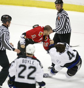 Calgary-05/29/04-Calgary Flames Jarome Iginla wrestles Tampa Bay Lightning's Vincent Lecavalier to the ground in the first period of NHL playoff action at the Saddledome Saturday.  Grant Black/Calgary Herald DATE PUBLISHED MAY 30, 2004 PAGE AA4 (EARLY) * Calgary Herald Merlin Archive *