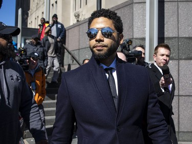 Actor Jussie Smollett leaves the Leighton Criminal Courthouse in Chicago on Tuesday March 26, 2019, after prosecutors dropped all charges against him. Smollett was indicted on 16 felony counts related to making a false report that he was attacked by two men who shouted racial and homophobic slurs.