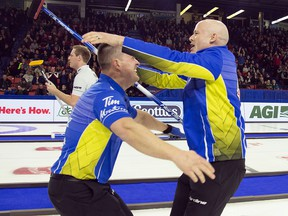 Team Alberta skip Kevin Koe (right) celebrates his win over Team Wild Card with lead Ben Hebert in the final draw at the Brier in Brandon, Man. Sunday, March 10, 2019. (THE CANADIAN PRESS/Jonathan Hayward)