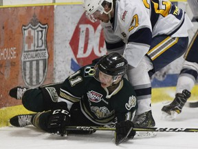 A file photo of Okotoks Oilers' Quinn Olson being checked to the ice. Olson is at the centre of a controversy during a playoff game between the Oilers and the Calgary Canucks.