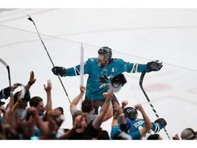 SAN JOSE, CA - APRIL 23: Joe Thornton #19 of the San Jose Sharks celebrates after a win in overtime against the Vegas Golden Knights in Game Seven of the Western Conference First Round during the 2019 NHL Stanley Cup Playoffs at SAP Center on April 23, 2019 in San Jose, California.