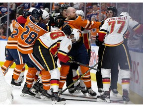 Zack Kassian (#44 centre) and the Edmonton Oilers battle the Calgary Flames during third period NHL action at Rogers Place, in Edmonton Saturday Jan. 19, 2019. Calgary won 5-2. Photo by David Bloom