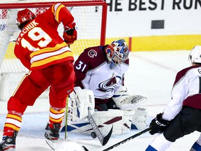 Colorado Avalanche goalie Philipp Grubauer makes a save on Matthew Tkachuk of the Calgary Flames late in the third period in game two of the Western Conference First Round during the 2019 NHL Stanley Cup Playoffs at the Scotiabank Saddledome in Calgary on Saturday, April 13, 2019. Al Charest/Postmedia