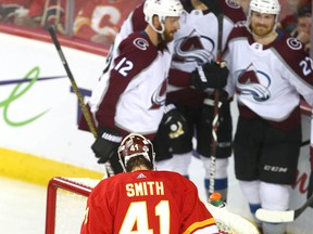Flames goalie Mike Smith looks on as Avalanche celebrate a third goal during game five between the Colorado Avalanche and Calgary Flames in Calgary on Friday, April 19, 2019. Jim Wells/Postmedia