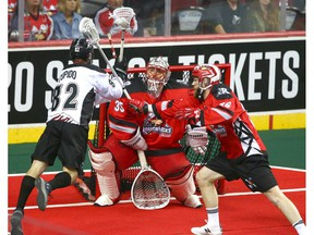 Roughnecks keeper Christian Del Bianco (C) stand his ground in net as Mammoth Joey Cupido takes a shot during National Lacrosse League West Division final action between the Calgary Roughnecks and Colorado Mammoth in Calgary on Friday, May 10, 2019. Jim Wells/Postmedia