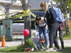 Friends of a girl killed in an explosion in Kincora lay some flowers at a memorial infront of the home in Calgary on Monday, May 27, 2019. Darren Makowichuk/Postmedia