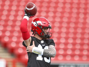 QB Bo Levi Mitchell stretches during the first session of Calgary Stampeders CFL training camp in Calgary Sunday, May 19, 2019. Jim Wells/Postmedia ders