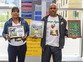 Renee Hill, left, and Reggie Hill, parents of Calgary Stampeder Mylan Hicks, pose for a photo at the Calgary Courts Centre on Thursday, May 30, 2019.