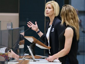 Small business owners Kelly Doody, left and Kristi Stuart plead for tax relief with City Council following a rally outside City Hall protesting huge hikes in business taxes on June 10. File photo by Gavin Young/Postmedia.