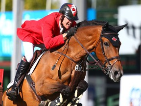 Ian Millar, from Canada, rides Dixson, in the Nations' Cup during the Masters at Spruce Meadows in Calgary on Saturday, September 8, 2018. Germany won the Nations' Cup and Canada finished second. Jim Wells/Postmedia
