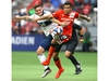 Whitecaps Jake Nerwinski (L) and Cavalry FC Jose Escalante battle for the ball during third round CPL Canadian Championships soccer action between Cavalry FC and Vancouver Whitecaps at BC Place in Vancouver, BC  Wednesday, July 24, 2019. Jim Wells/Postmedia