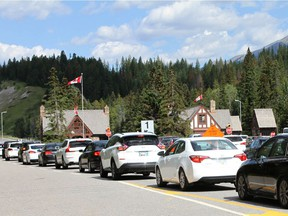Visitors stream into Banff National Park on Friday, August 2, 2019. The August long weekend is an extremely busy time with thousands visiting the park west of Calgary.