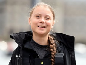 Climate change activist Greta Thunberg speaks at a press conference before setting sail for New York in the 60ft Malizia II yacht from Mayflower Marina, on August 14, 2019 in Plymouth, England.