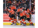 The Calgary Flames celebrate a goal by Adam Ruzicka against the Edmonton Oilers during the Battle of Alberta prospects game at Scotiabank Saddledome in Calgary on Tuesday night. Photo by Azin Ghaffari/Postmedia.