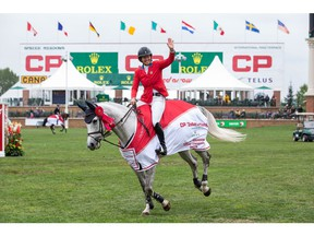 CALGARY, AB - SEPTEMBER 08: Beezie Madden takes a victory lap while riding Darry Lou during the Spruce Meadows Masters, part of the Rolex Grand Slam of Show Jumping at Spruce Meadows on September 8, 2019 in Calgary, Canada.