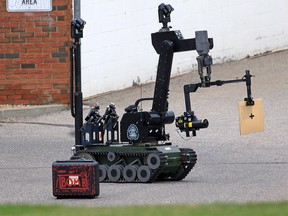 Police use a bomb disposal robot to investigate a suspicious package in Vista Heights on Monday morning, Sept. 9, 2019.