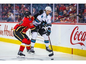 Sep 18, 2019; Calgary, Alberta, CAN; San Jose Sharks defenseman Brenden Dillon (4) and Calgary Flames center Dillon Dube (29) battle for the puck during the first period at Scotiabank Saddledome. Mandatory Credit: Sergei Belski-USA TODAY Sports ORG XMIT: USATSI-406631