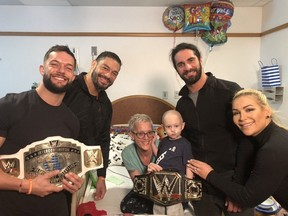 Myself, Finn Balor, Roman Reigns, and Seth Rollins visiting Rocco and presenting him with his own WWE Championship belt at the Pittsburgh Children's Hospital in March 2019.